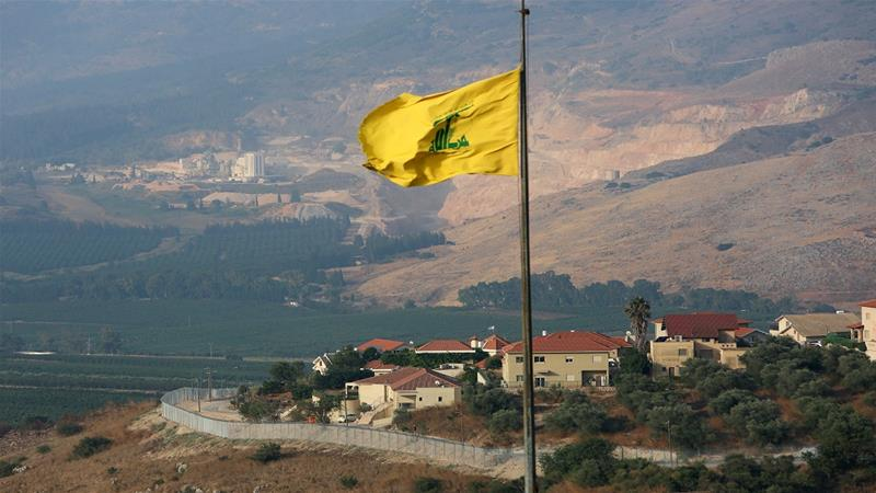 A Hezbollah flag flutters in the southern Lebanese village of Khiam, near the border with Israel, on Tuesday [Aziz Taher/Reuters]
