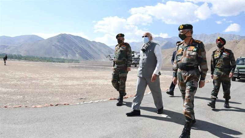 Modi takes veiled dig at China on visit to disputed border area