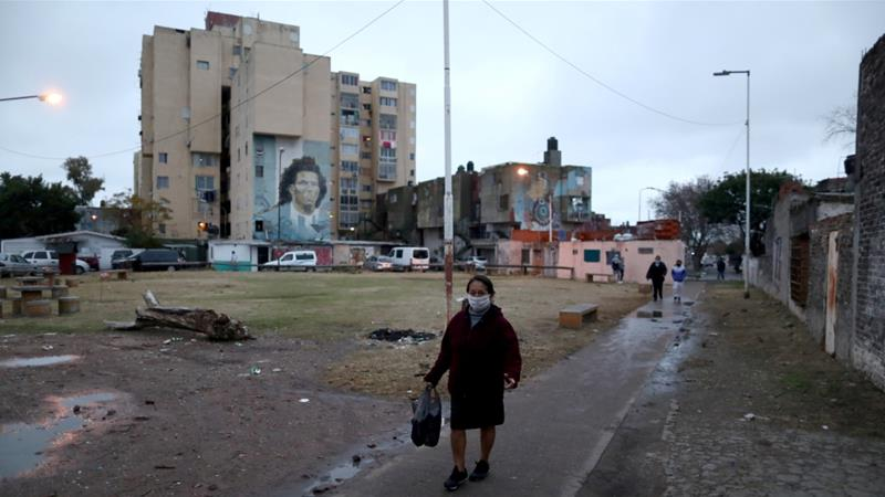 A woman wearing a face mask during the outbreak of the coronavirus in Fuerte Apache on the outskits of Buenos Aires, Argentina, a country facing a severe economic downturn this year [File: Agustin Marcarian/Reuters]