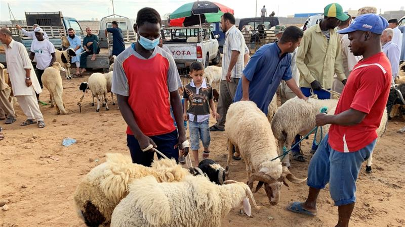 Muslims sacrifice sheep on first day of Eid