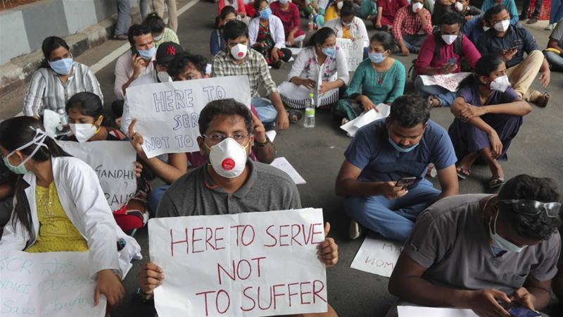 Junior doctors from Government Gandhi Hospital protest outside the hospital, demanding action against the attack on a colleague in Hyderabad, India on June 10, 2020  [File: AP/Mahesh Kumar A]