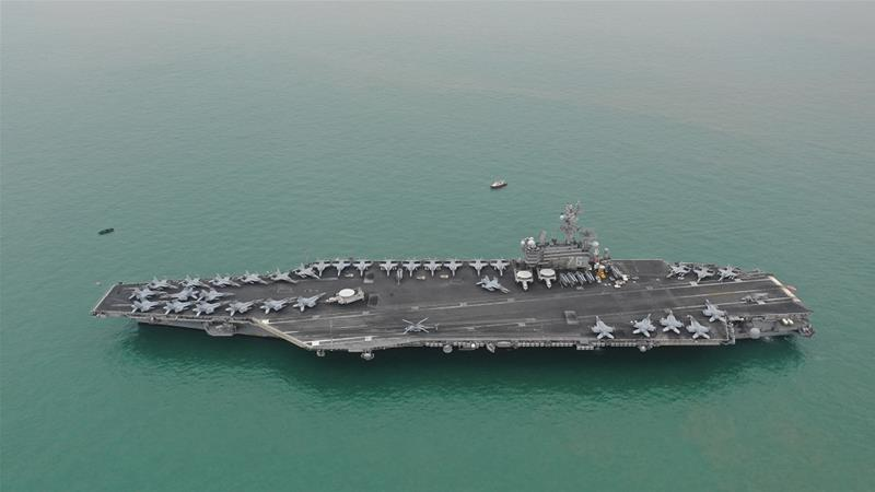Aircraft carrier USS Ronald Reagan is one of two conducting drills in the South China Sea [Liang Yingfei/Caixin Media via Reuters]