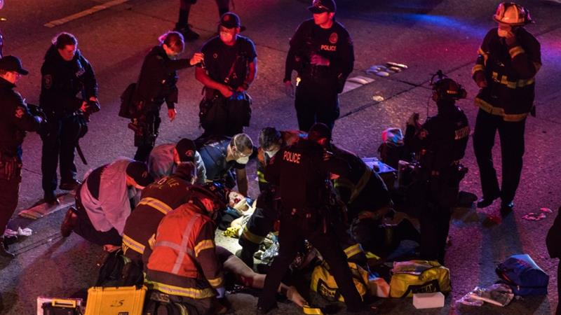Two Seattle protesters hit by auto on highway, one critically injured