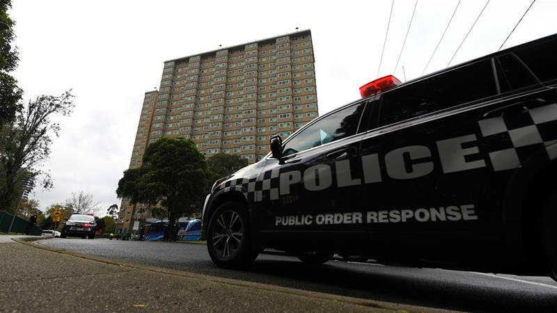 Victoria police arrive at the public housing towers along Racecourse Road that were placed under lockdown due to the coronavirus disease (COVID-19) outbreak in Melbourne, Australia [James Ross/AAP Image via Reuters]