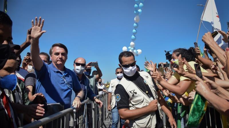 Andre Borges/AP]