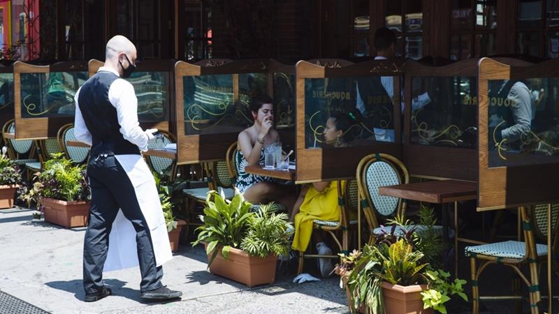 A number of officials across the US have delayed or rescinded permissions for opening indoor dining at restaurants, citing coronavirus concerns [Angus Mordant/Bloomberg]