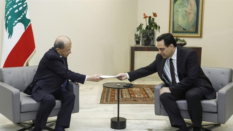 Lebanon's Prime Minister Hassan Diab submits his resignation to President Michel Aoun at the presidential palace in Baabda, Lebanon [Dalati Nohra/Handout via Reuters]