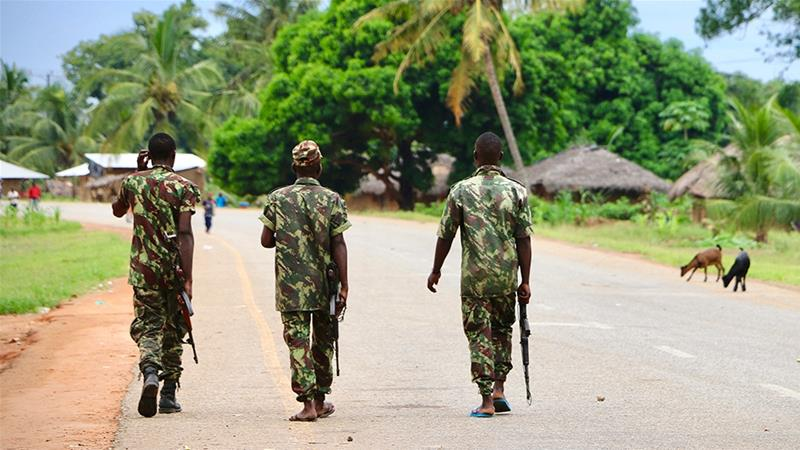 Soldiers patrol the streets following a two-day attack in March 2018 in Mocimboa da Praia, Mozambique [Adrien Barbier/AFP]