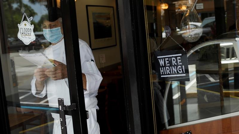 USA weekly jobless claims fall below 1M