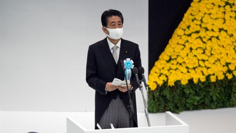 Abe, in office since 2012 in his second stint as prime minister, resigned from his first stint in 2007 because of struggles with ulcerative colitis [Carl Court/Pool via Reuters]