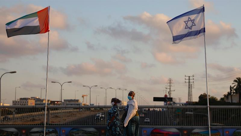 UAE and Israeli flags are seen in Netanya, Israel after the establishment of full diplomatic relations between the two states [Ariel Schalit/AP]