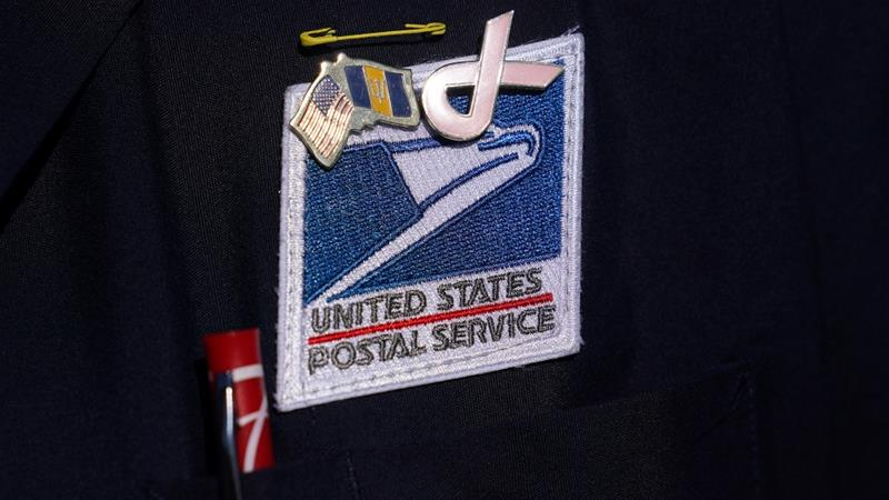 A US Postal Service badge is pictured during a news conference about the postal service in the Manhattan borough of New York City [Carlo Allegri/Reuters]