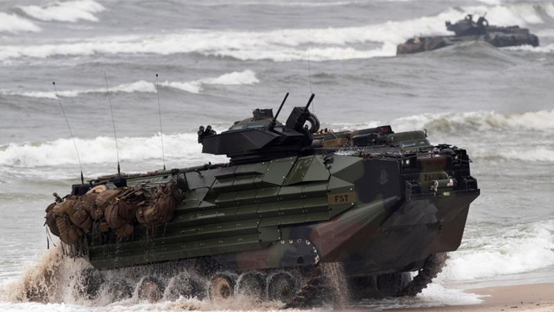 The personnel were on board a  marine amphibious assault vehicle that sank in the waters off Southern California on Thursday [File: Mindaugas Kulbis/The Associated Press]