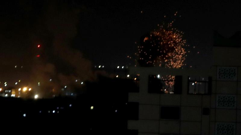 Flames and smoke are seen during an Israeli air raid on Gaza on Thursday [Mohammed Salem/Reuters]