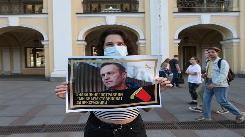 A woman attends a gathering to show support for Russian opposition leader Alexei Navalny in St Petersburg [Igor Russak/Reuters]