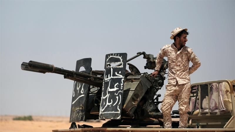 A member of the self-styled Libyan National Army (LNA) commanded by Khalifa Haftar stands on a military vehicle at one of their sites west of Sirte, Libya [Esam Omran Al-Fetori/Reuters]