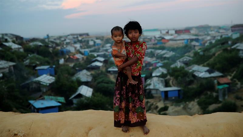 Rohingya refugee children pose for a picture at the Balukhali camp in Cox's Bazar, Bangladesh, November 15, 2018 [Mohammad Ponir Hossain/Reuters]