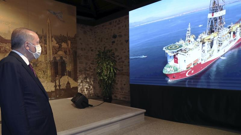 President Recep Tayyip Erdogan watches a drilling ship, Fatih, in the background, as he speaks about the recent natural gas discovery, Istanbul,Turkey, August 21, 2020 [Turkish Presidency via AP]