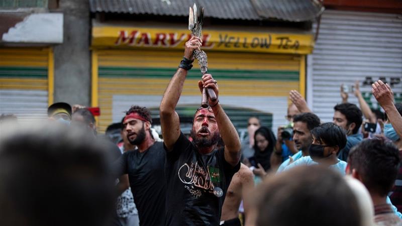 Kashmiri Muslims during a Muharram procession in the main city of Srinagar [Mukhtar Khan/AP Photo]