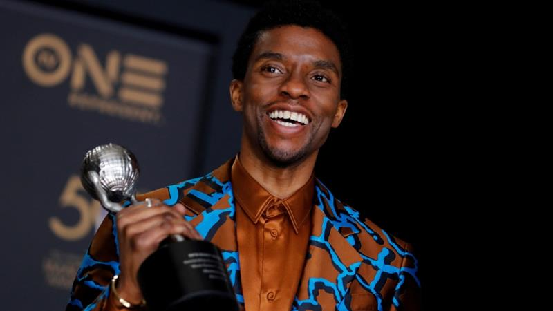 Chadwick Boseman poses backstage with his Outstanding Actor in a Motion Picture award for Black Panther [File: Mike Blake/Reuters]