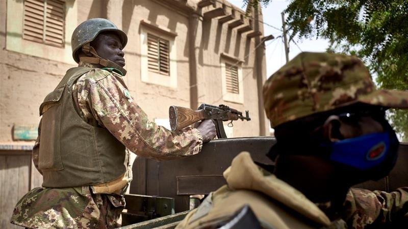 Soldiers of the Malian army patrolling the old town of Djenne in central Mali [File: Michele Cattani/AFP]