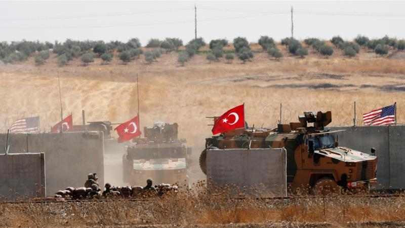 Turkish troops return after a joint US-Turkey patrol in northern Syria, as seen from near the Turkish town of Akcakale, Turkey, on September 8, 2019 [Reuters/Murad Sezer]