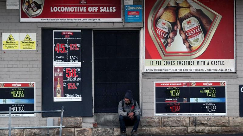 A man outside a closed liquor store during a nationwide coronavirus lockdown in Cape Town, South Africa, where an animal rights group is pressing the government to introduce new regulations on how live animals are transported [File: Mike Hutchings/Reuters]
