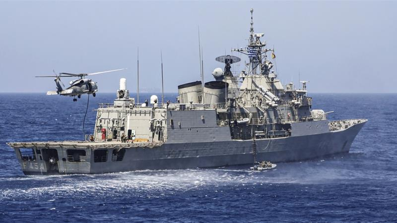 A Greek frigate and a helicopter perform military exercises in the eastern Mediterranean Sea in August [Greek defence ministry via AFP]
