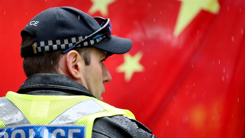 China accuses Australia of helping reporters 'evade' investigation