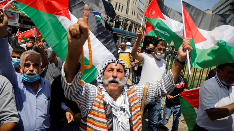 Palestinians take part in a protest against the United Arab Emirates's deal with Israel to normalise relations, in Nablus in the occupied West Bank [File: Raneen Sawafta/Reuters]