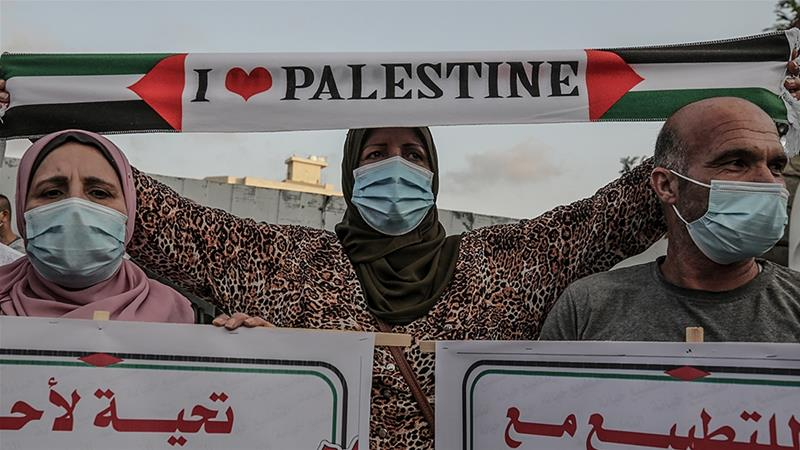 Palestinians protest the agreement between Israel and the United Arab Emirates and Bahrain on Tuesday [Mohammed Saber/EPA]