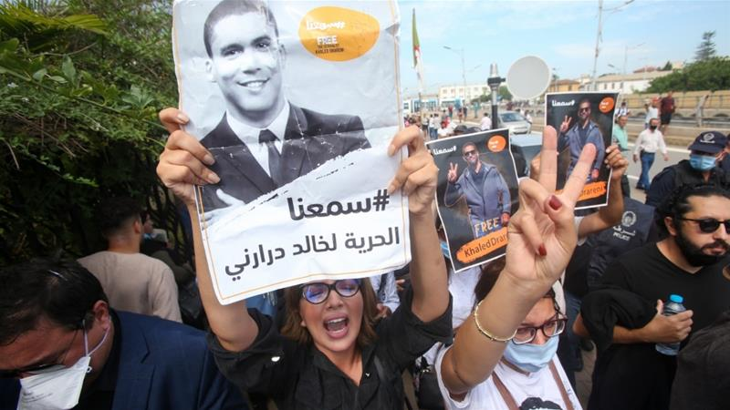 Algerian protesters gather outside the court in Algiers in support of journalist Khaled Drareni during his appeal [AFP]