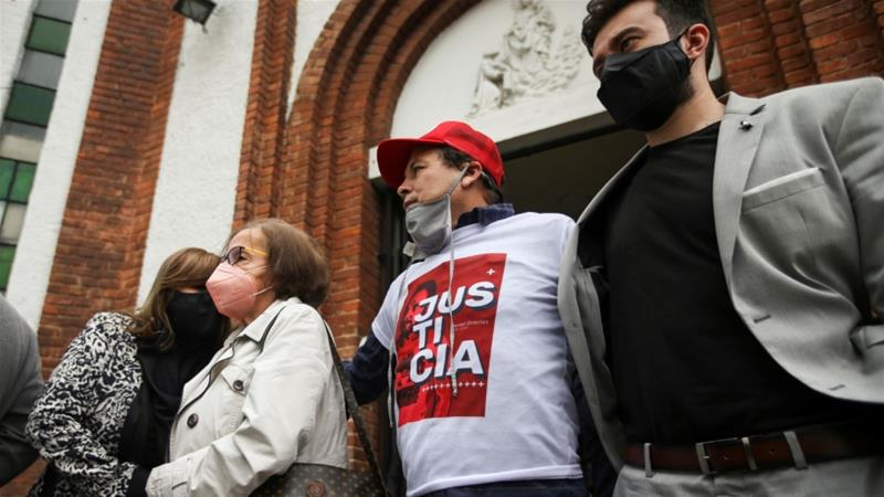 A family member of Javier Ordonez wears a t-shirt that reads 'Justice for Javier' during his funeral in Bogota [Luisa Gonzalez/Reuters]