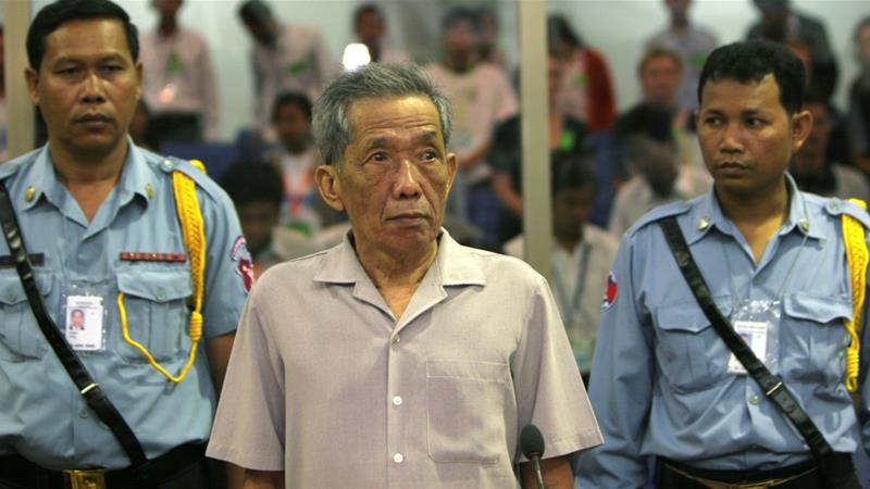 Kaing Guek Eav better known as Duch stands in a courtroom during a pre-trial in Phnom Penh in 2008