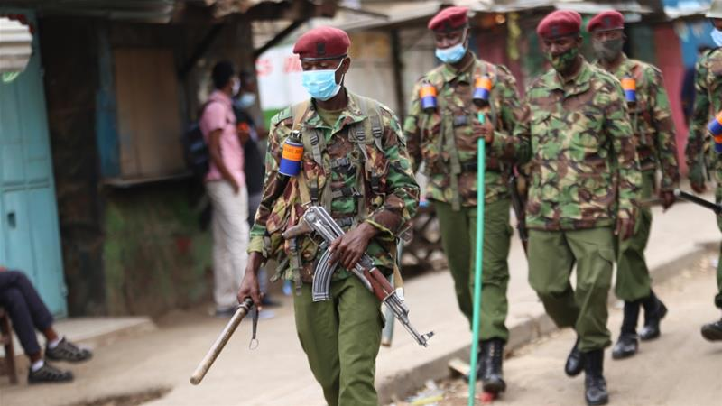 Police officers patrol the streets of Eastleigh during a demonstration against COVID-19 restrictions, May 11, 2020, Nairobi, Kenya [Billy Mutai/LightRocket via Getty Images]