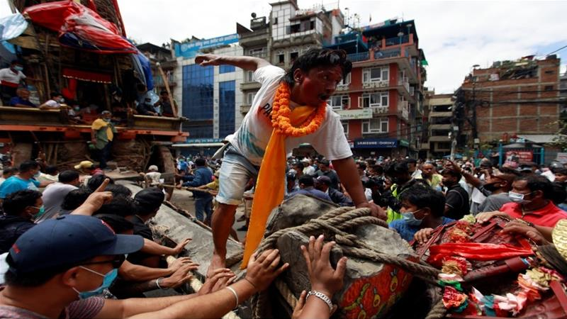 During the month-long festival, a chariot with the deity Rato Machindranath is pulled around the city of Lalitpur for a month [Navesh Chitrakar/Reuters]