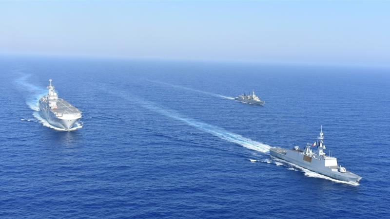 Greek and French vessels sail in formation during a joint military exercise in the Mediterranean sea [File: Greek Ministry of Defence Handout/Reuters]