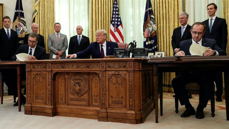 US President Donald Trump hosts a signing ceremony with Serbia's President Aleksandar Vucic and Kosovo's Prime Minister Avdullah Hoti at the White House in Washington, DC [Leah Millis/Reuters]