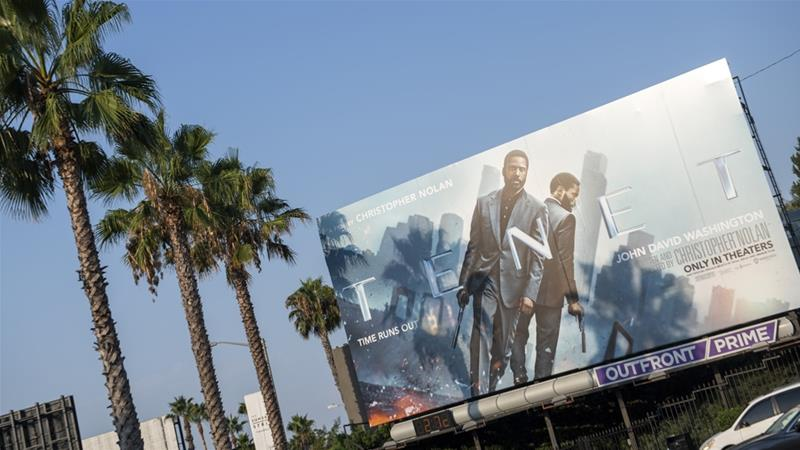 A billboard for Tenet, the latest film from director Christopher Nolan, in West Hollywood, California, the United States [Valerie Macon/AFP]