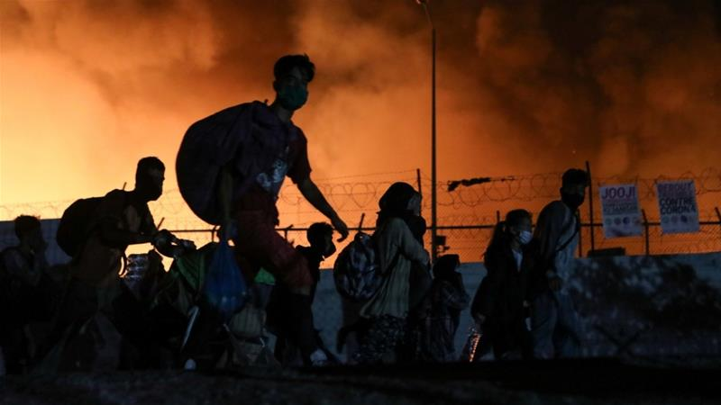 Everything is burning': Refugees flee as fire guts Moria camp | News | Al  Jazeera