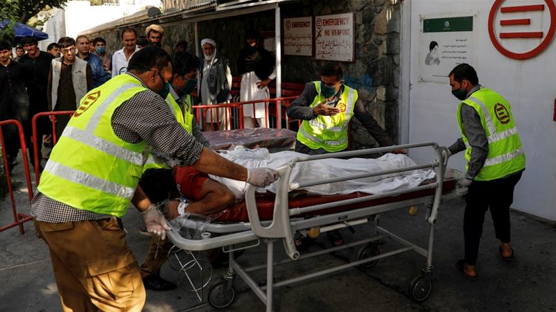 Afghan men carry an injured to a hospital after a blast in Kabul [Mohammad Ismail/Reuters]