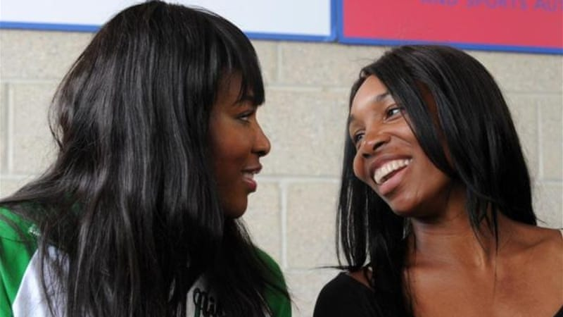 After winning WTA Championships Serena (L) is joining forces with sister Venus in Nigeria [AFP]