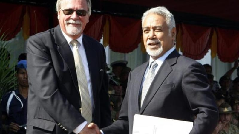 Finn Reske-Nielsen, left, shakes hands with Prime Minister Xanana Gusmao during a handover ceremony [EPA]
