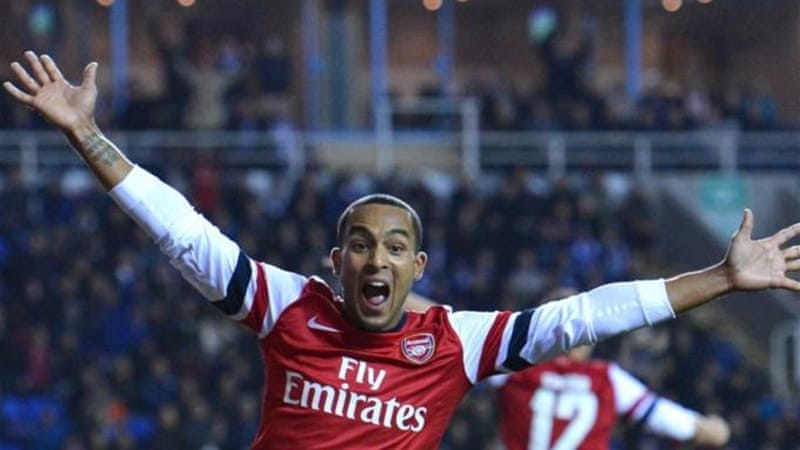 Theo Walcott scored hat-trick as Arsenal battled back against Reading in the most unlikely fashion [AFP]