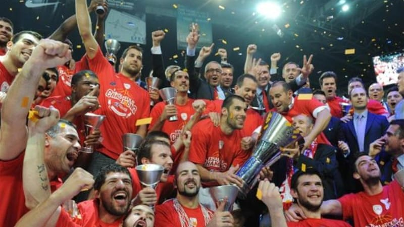Olympiakos Piraeus celebrate with trophy after winning Euroleague Final in May 2012 [AFP]