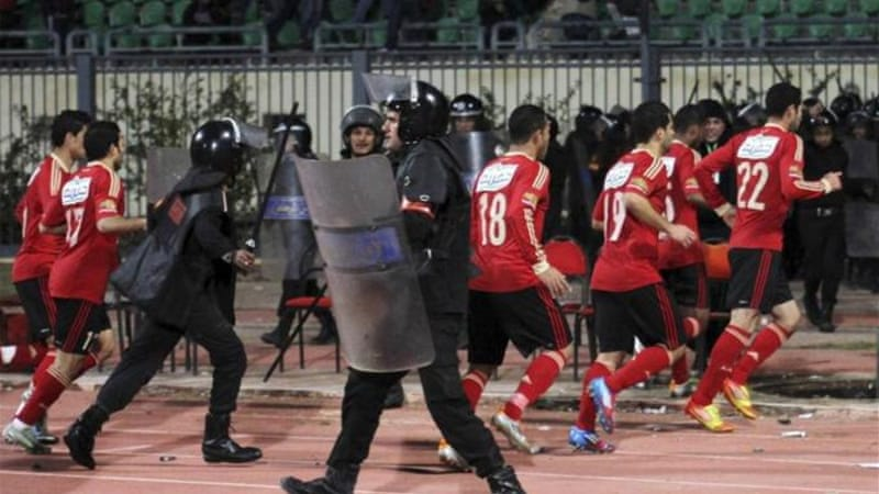 Al Ahli soccer players flee as fans invade the Port Said stadium on February 1st 2012 [Reuters]