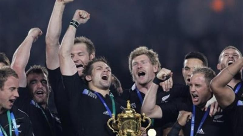 Richie McCaw (left of trophy) captained New Zealand to World Cup glory in October 2011 [AP]