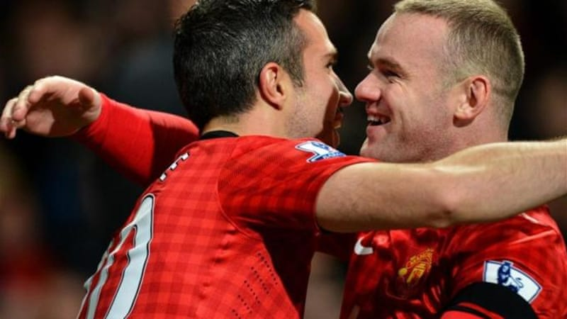 Robin van Persie (L) celebrates with Wayne Rooney after once more delivering the goods for United [AFP]