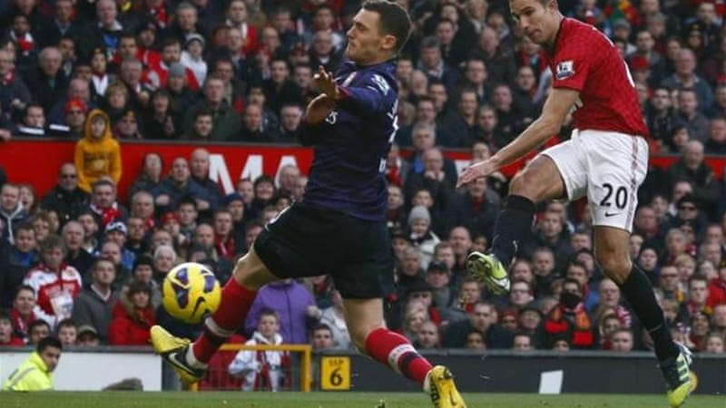 The sight no Arsenal fan wanted to see: Van Persie scoring a goal against them in a United shirt [Reuters]