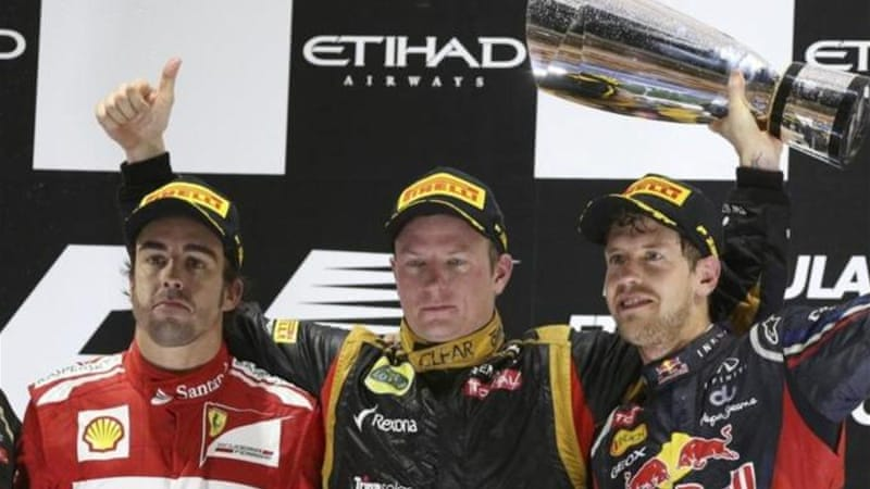Kimi sandwich: Both Alonso (L) and Vettel (R) are battling to become the World Champion for the third time [AP]